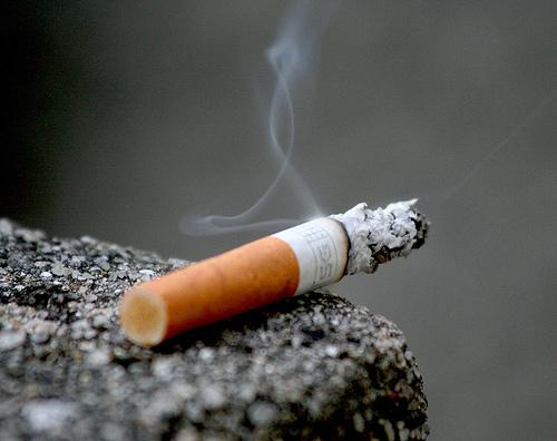 SYMBOL burning cigarette