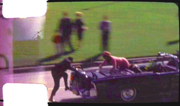 jackie-kennedy-climbs-out-the-back-of-the-limo